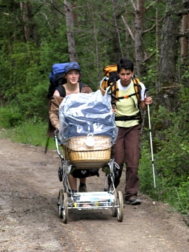 Anna and Tunde with baby Penelope in the pram