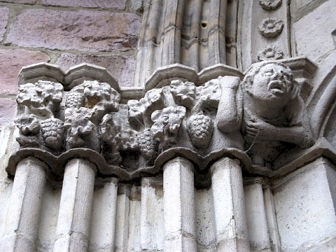 Carving above the door on the Eglise Notre Dame de Bout du Port