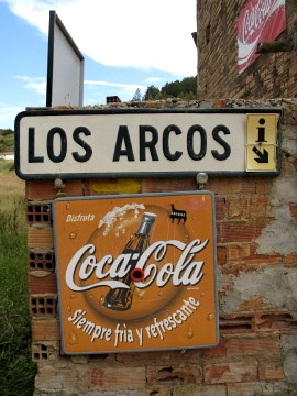 Coke sign welcoming us to Los Arcos