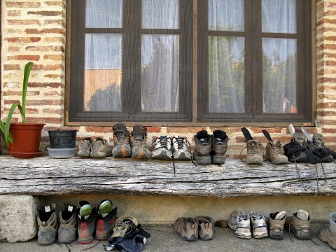 Pilgrim boots left out to air at the albergue
