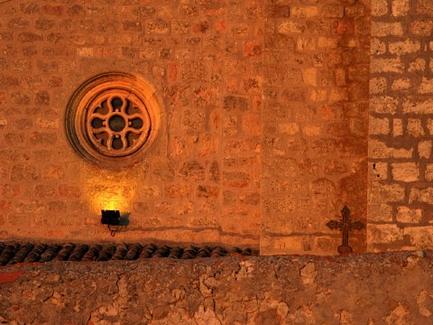 Sunset detail of church wall in Atapuerca