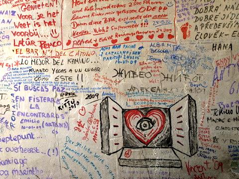The wall of the bar was covered in notes left by past pilgrims