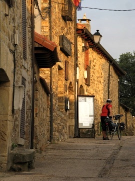 A cyclist heads off from Rabanal del Camino