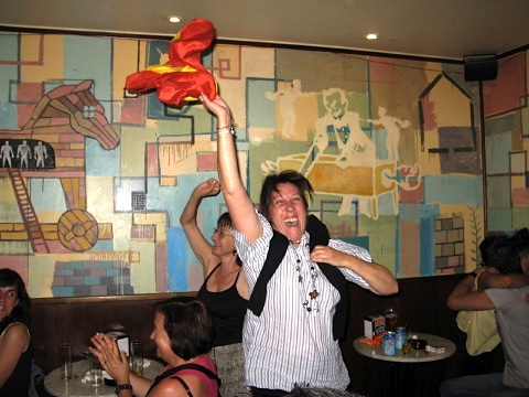 A local celebrates the winning goal in the World Cup final