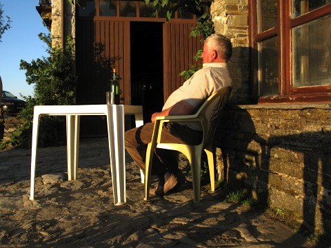 A local enjoys a glass of wine in the evening