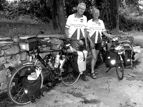 At the pilgrim cemetery, two Dutch cyclists stop for a rest