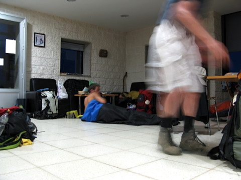 Walkers wake up before dawn in the albergue in Negreira