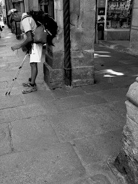 A pilgrim outside the Pilgrim Office in Santiago de Compostela